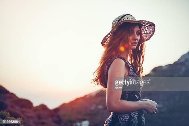 Boho girl enjoying nature with summer sunflare