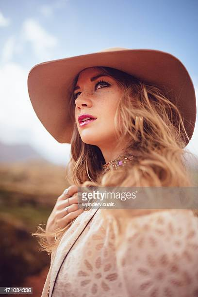 Boho girl in fashion hat with summer sky
