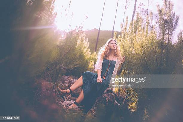 Boho girl surrounded by nature in springtime