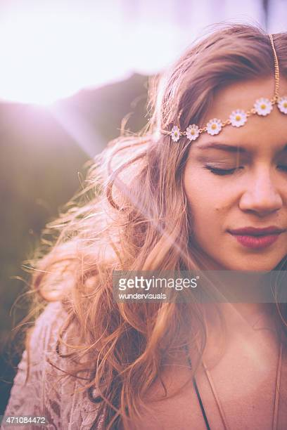 Boho girl with flowered jewellery in her hair