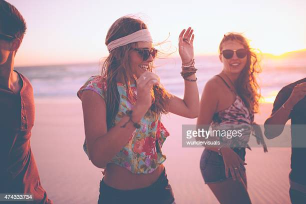 Boho Girls dancing at a summer evening beachparty