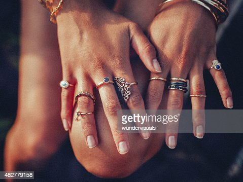 Boho girl's hands looking feminine with many rings