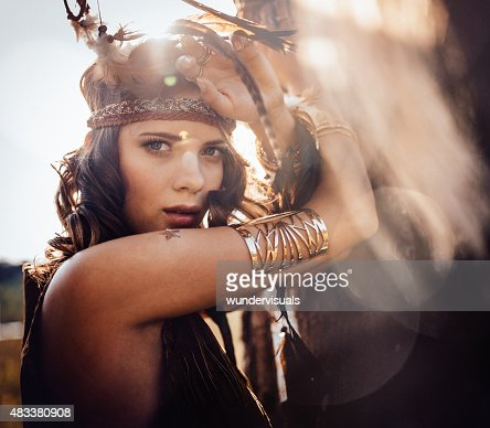 Boho style girl outdoors with sun flare
