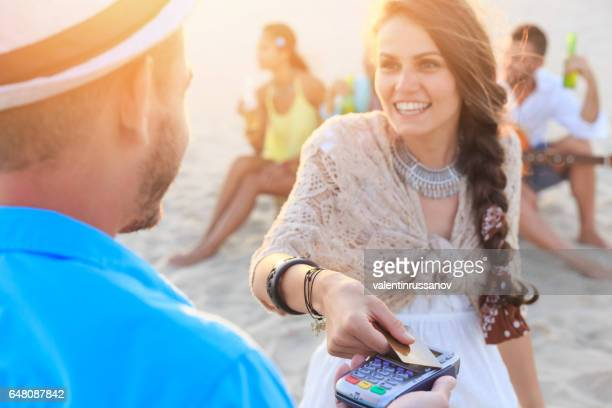 Boho woman using credit card for contactless payment