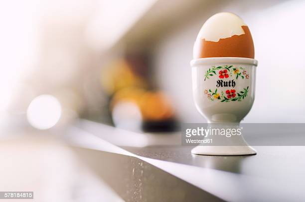 Boiled egg in painted egg cup, female forname Ruth