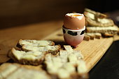 Boiled egg with buttered bread