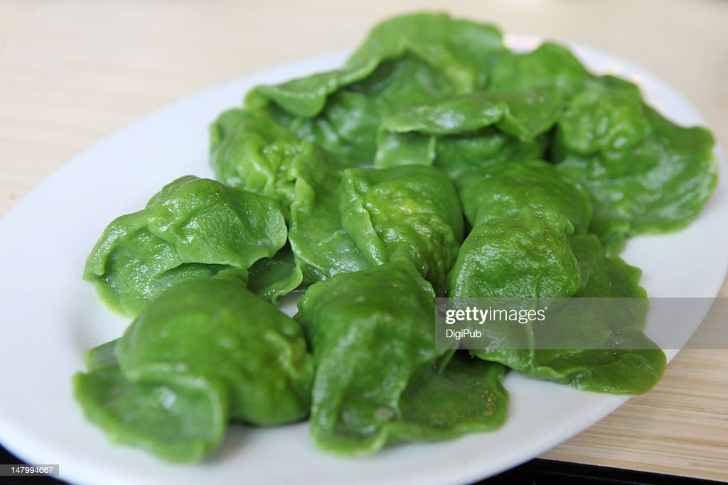 Boiled green chinese dumplings : Stock Photo