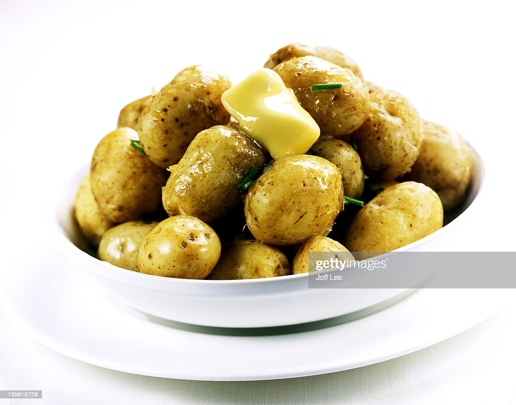 Boiled new potatoes with melting butter