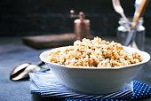 boiled quinoa in white bowl, stock photo