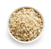 Bowl of Boiled Quinoa seeds isolated on white background