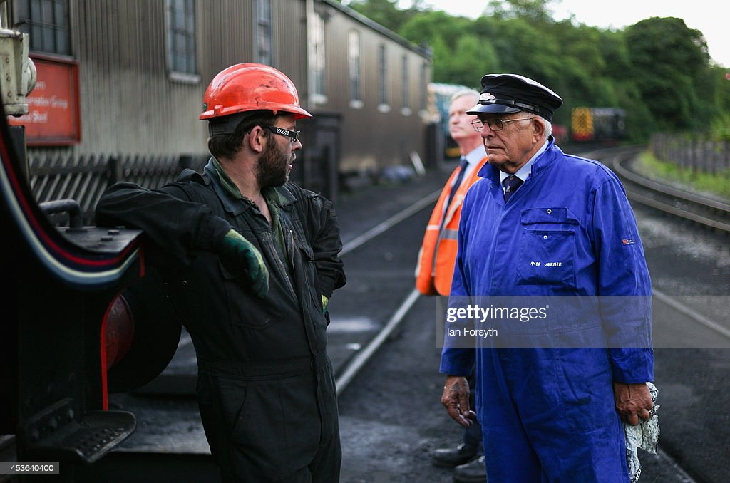 Boilersmith Mark O'Brian (L) speaks with engine driver Gerry Skelton at Grosmont train engine sheds prior to a ceremony to mark a second platform opening at Whitby train station on August 15, 2014 in Whitby, England. The second platform will provide passengers with more options for travel to the Yorkshire seaside town on the North Yorkshire Moors Railway and was the first time in half a century two steam locomotives were side by side at the station.