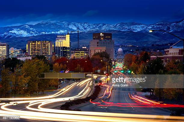 Boise Idaho downtown at dusk with fresh snow on hills and long exposure light trails