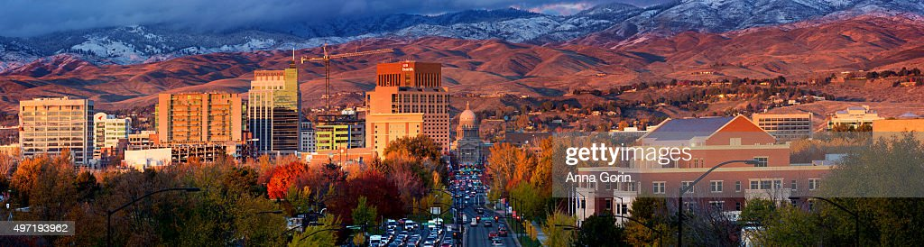 Boise Idaho downtown at sunset with fresh snow on hills, panoramic