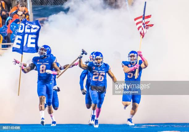 Boise State Broncos cornerback Avery Williams leads his teammates onto the field with 'the hammer' during the regular season game between the Wyoming...