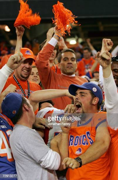 Boise State Broncos fans celebate in the stands after watching the their team defeat the Oklahoma Sooners 4342 at the Tostito's Fiesta Bowl at...