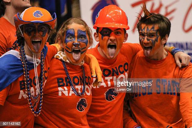 Boise State Broncos fans celebrate a win over the 24th ranked Oregon Ducks on December 12 2015 at Taco Bell Arena in Boise Idaho Boise State won the...