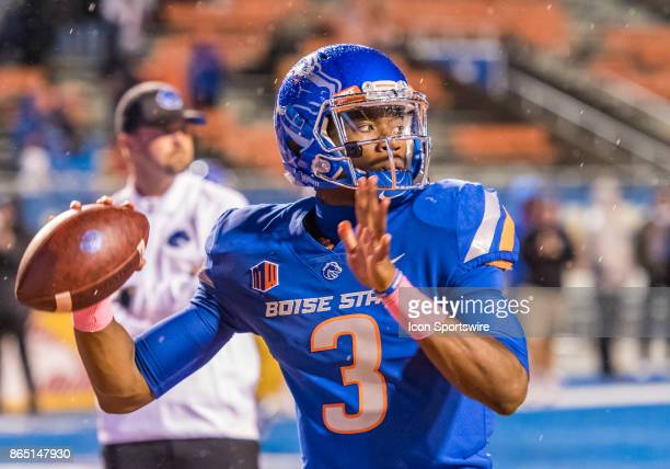 Boise State Broncos quarterback Montell Cozart warming up in the rain before the regular season game between the Wyoming Cowboys verses the Boise...