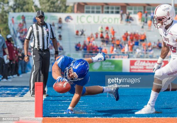 Boise State Broncos tight end Jake Roh attempts to get an extra stretch toward the goal line during the nonconference season opener between the Troy...