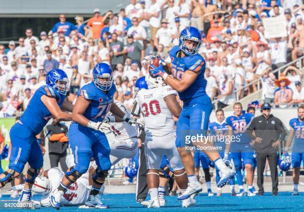 Boise State Broncos tight end Jake Roh pulls down a pass during the nonconference season opener between the Troy Trojans and the Boise State Broncos...