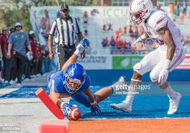 Boise State Broncos tight end Jake Roh puts the ball down just inside the goal marker for a 4th quarter touchdown during the nonconference season...