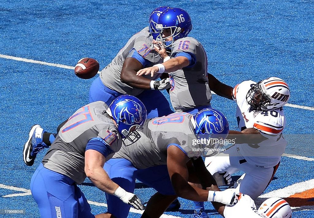 Boise State quarterback Joe Southwick fumbles fumbles the ball under pressure from TennesseeMartin linebacker Tony Bell in the first half at Bronco...