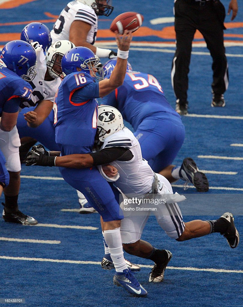 Boise State quarterback Joe Southwick gets a pass off just before a hit by Brigham Young defensive back Preston Hadley at Bronco Stadium in Boise...