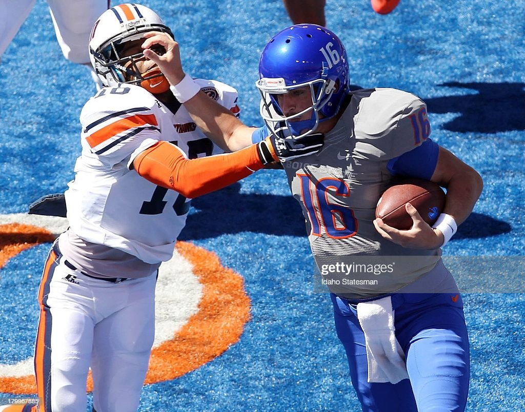 Boise State quarterback Joe Southwick right fights off TennesseeMartin defensive back Leon Carlton III in the first half at Bronco Stadium in Boise...