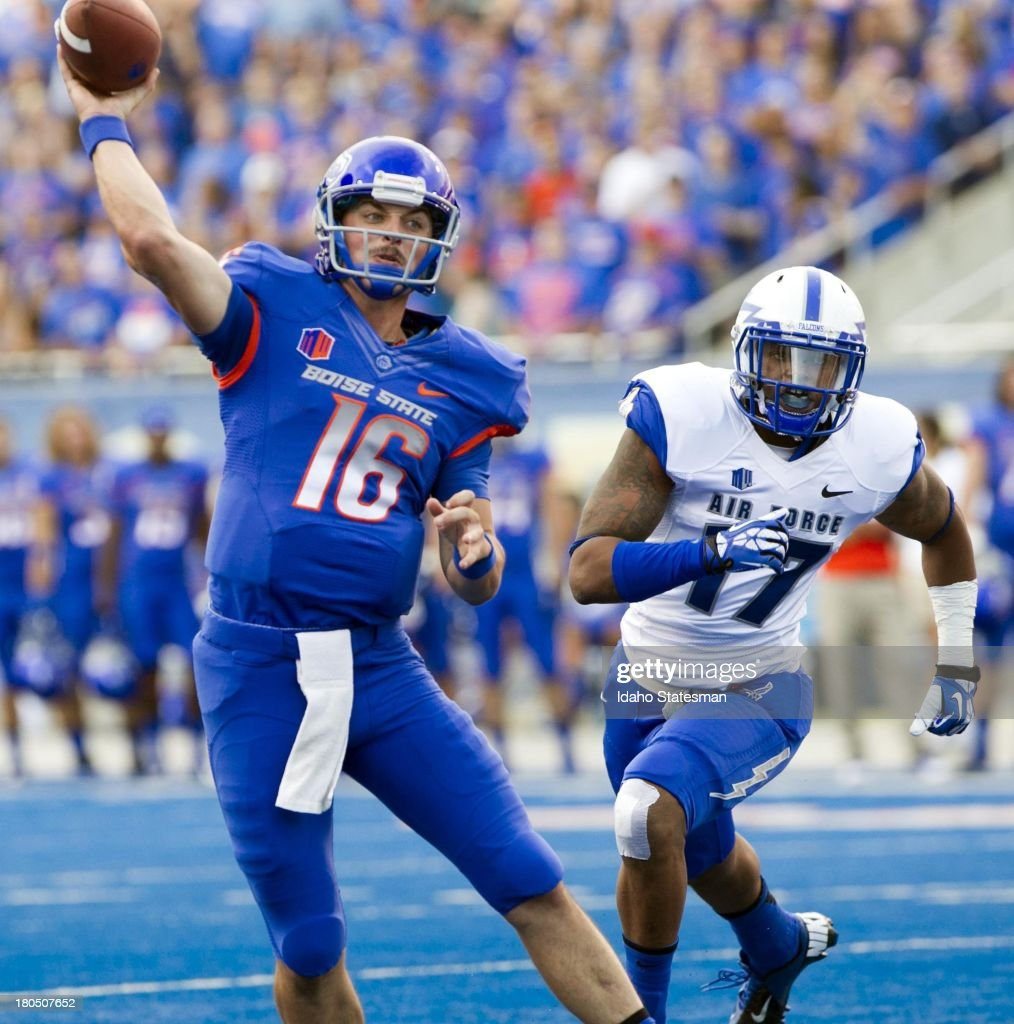 Boise State quarterback Joe Southwick throws a 9yard touchdown pass while being chased by Air Force defensive back Jamal Byrd in the first quarter on...