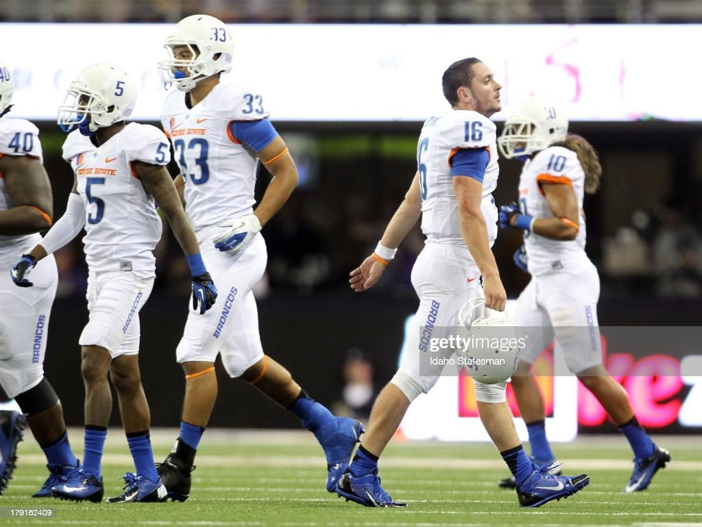 Boise State quarterback Joe Southwick walks off the field as the defense walks on in the second half against Washington at Husky Stadium in Seattle...