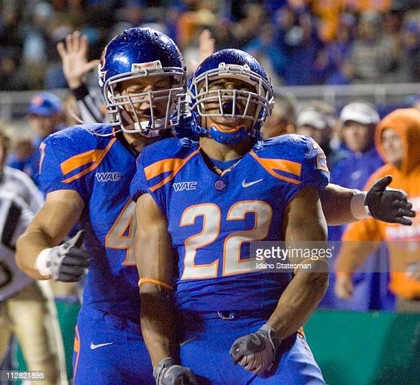 Boise State running back Doug Martin celebrates his touchdown run in the fourth quarter against UC Davis at Bronco Stadium in Boise Idaho Saturday...