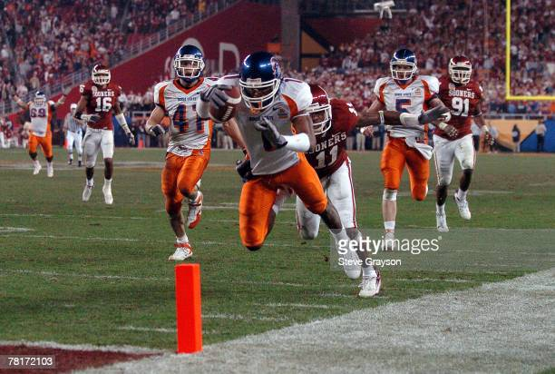 Boise State wide receiver Jerard Rabb dives into the end zone to tie the game at 35 with 7 seconds left to play during the Fiesta Bowl between Boise...