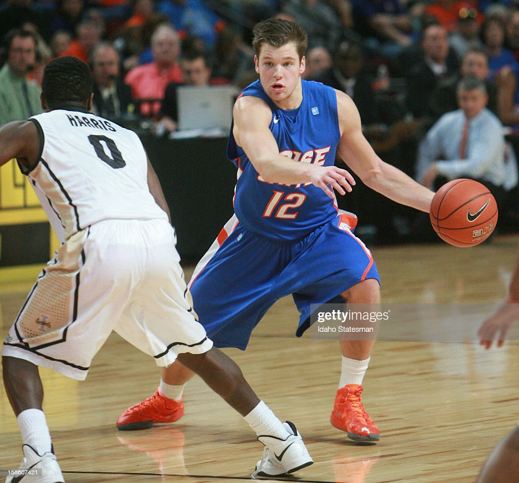 Boise State's Igor Hadziomerovic drives past Idaho's Robert Harris Jr. during a college basketball game on Thursday, December 20, 2012, in Boise, Idaho.