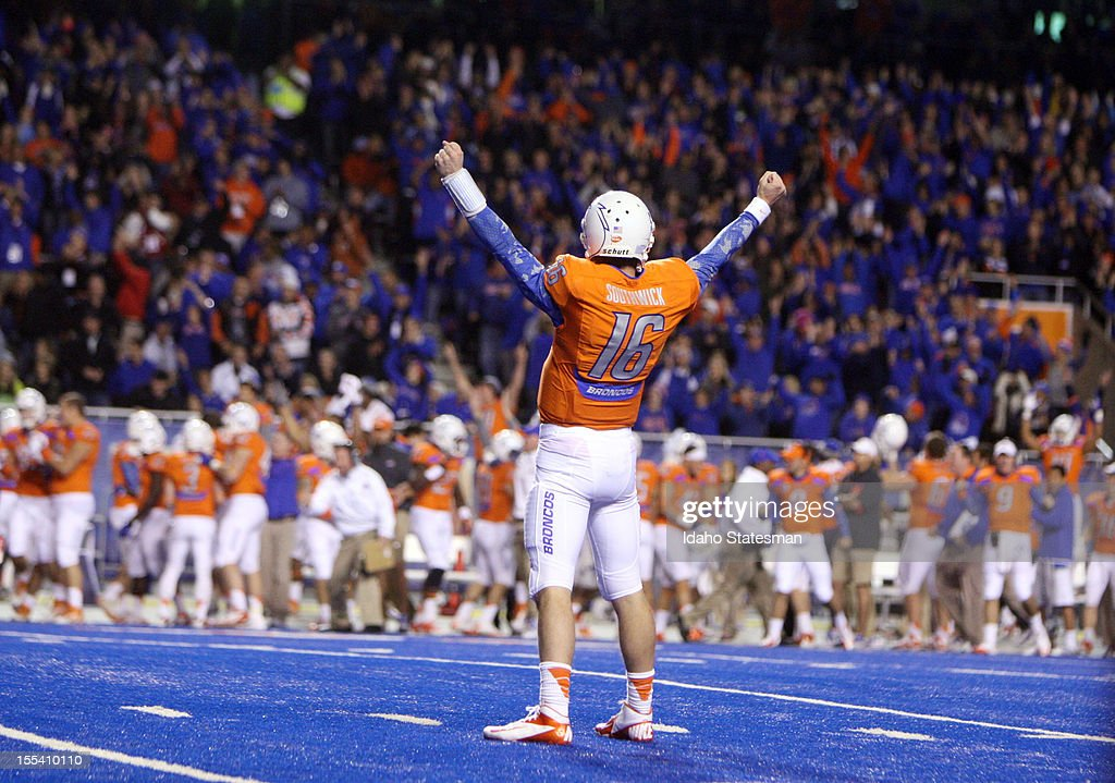 Boise State's Joe Southwick celebrates DJ Harper's second touchdown of the game against San Diego State at Bronco Stadium on Saturday November 3 in...