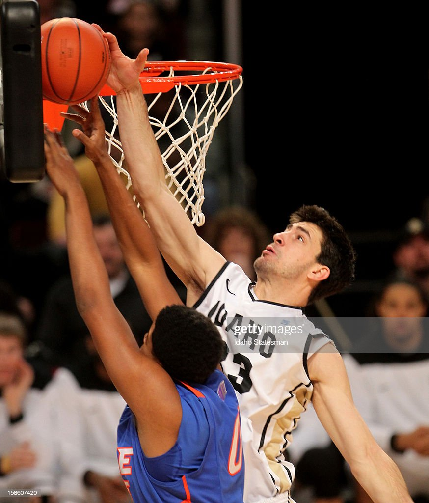 Boise State's Ryan Watkins gets his shot blocked by Idaho's Kyle Barone during a college basketball game on Thursday, December 20, 2012, in Boise, Idaho.