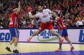 Bojan Beljanski of Serbia and Nenad Vuckovic of Serbia defend against Thomas Mogensen of Denmark during the Men's European Handball Championship...