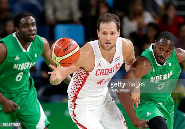 Bojan Bogdanovic of Croatia battles Ike Diogu and Michael Umeh of Nigeria for a loose ball during the preliminary round game at the Rio 2016 Olympic...