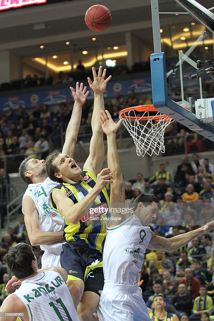 Bojan Bogdanovic #44 of Fenerbahce Ulker competes with Marco Carraretto #9 and Benjamin Ortner #16 of Montepaschi Siena during the 2012-2013 Turkish Airlines Euroleague Top 16 Date 2 between Fenerbahce Ulker Istanbul v Montepaschi Siena at Fenerbahce Ulker Sports Arena on January 4, 2013 in Istanbul, Turkey.