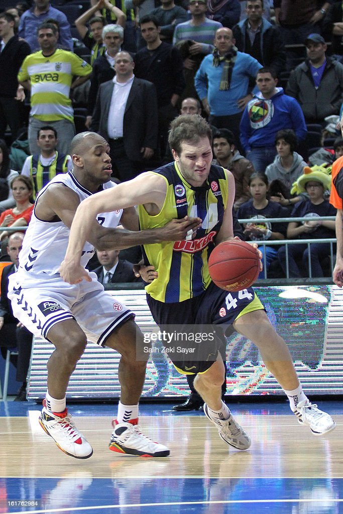 Bojan Bogdanovic #44 of Fenerbahce Ulker Istanbul competes with Patrick Christopher #23 of Besiktas JK Istanbul during the 2012-2013 Turkish Airlines Euroleague Top 16 Date 7 between Fenerbahce Ulker Istanbul v Besiktas JK Istanbul at Fenerbahce Ulker Sports Arena on February 15, 2013 in Istanbul, Turkey.
