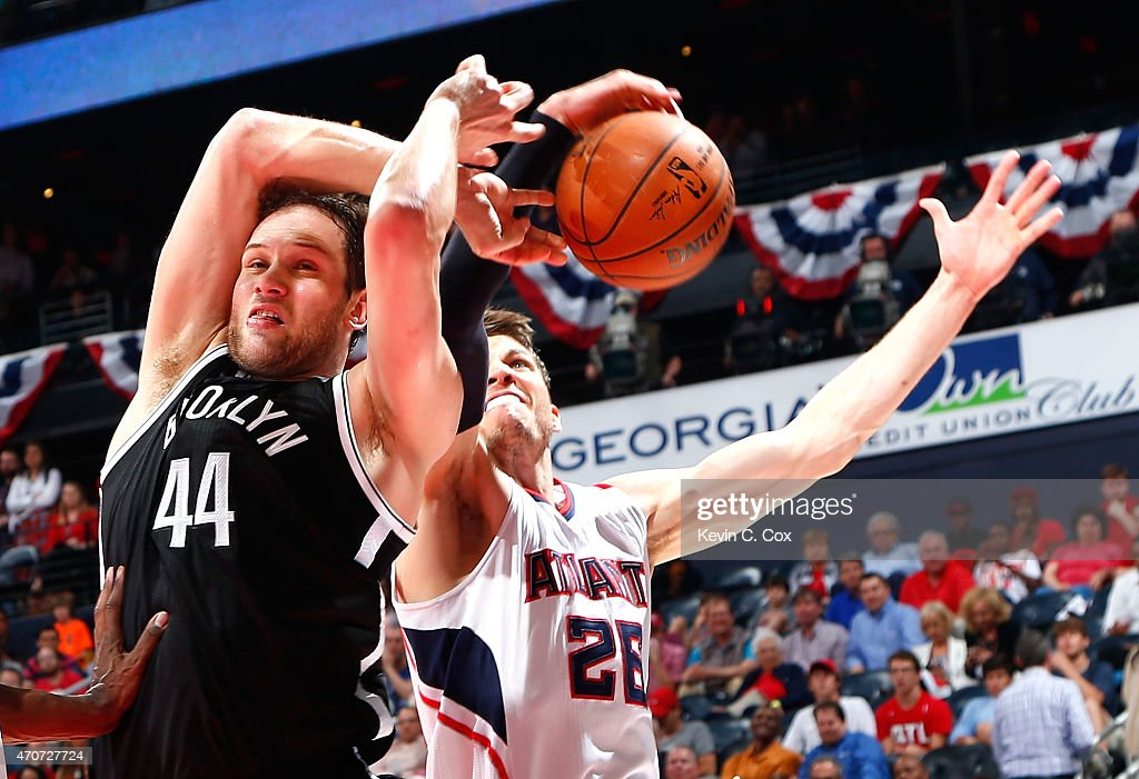 Bojan Bogdanovic #44 of the Brooklyn Nets draws a foul as Kyle Korver #26 of the Atlanta Hawks attempts to strip the ball during Game Two of the Eastern Conference Quarterfinals of the NBA Playoffs at Philips Arena on April 22, 2015 in Atlanta, Georgia.