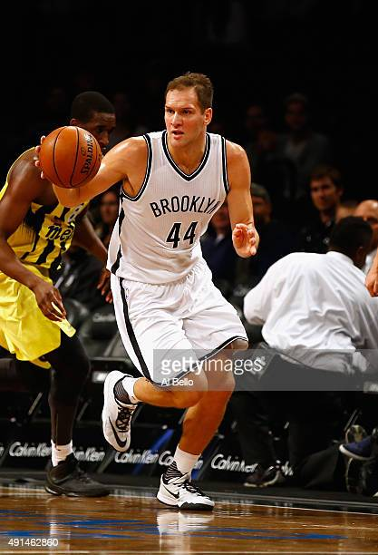 Bojan Bogdanovic of the Brooklyn Nets drives against Fenerbahce during their Pre Season game at the Barclays Center on October 5 2015 in New York...