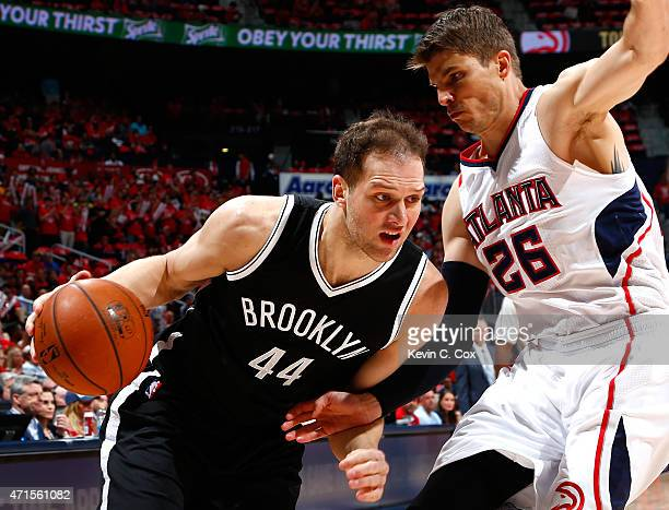 Bojan Bogdanovic of the Brooklyn Nets drives against Kyle Korver of the Atlanta Hawks during Game Five of the Eastern Conference Quarterfinals of the...