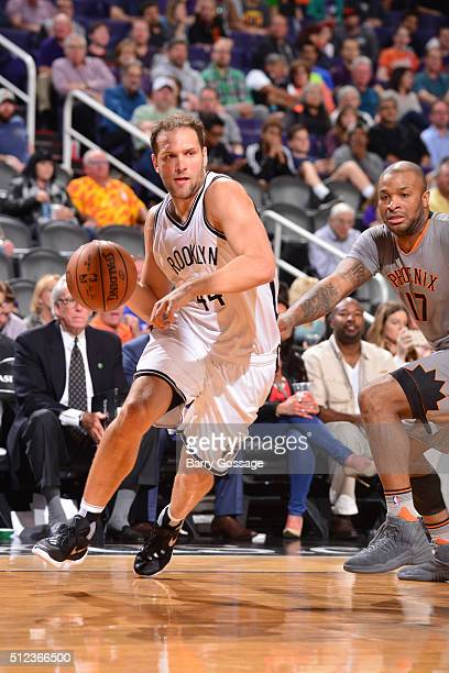 Bojan Bogdanovic of the Brooklyn Nets drives to the basket against the Phoenix Suns during the game on February 25 2016 at Talking Stick Resort Arena...