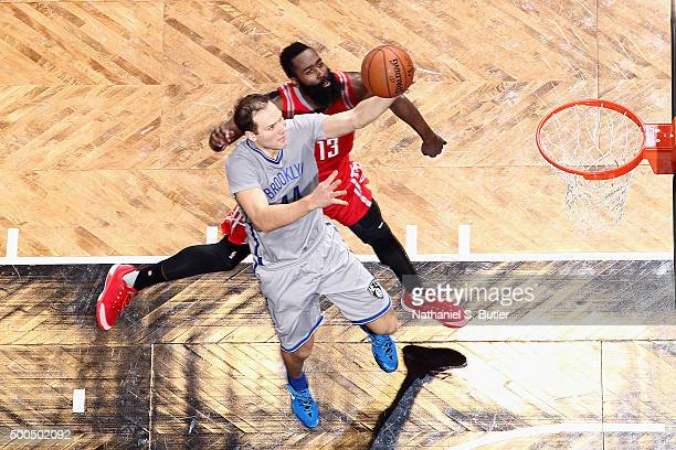 Bojan Bogdanovic of the Brooklyn Nets goes for the layup during the game against James Harden of the Houston Rockets on December 8 2015 at Barclays...