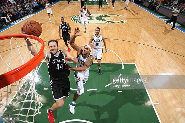 Bojan Bogdanovic of the Brooklyn Nets goes to the basket against Jerryd Bayless of the Milwaukee Bucks on November 7 2015 at the BMO Harris Bradley...
