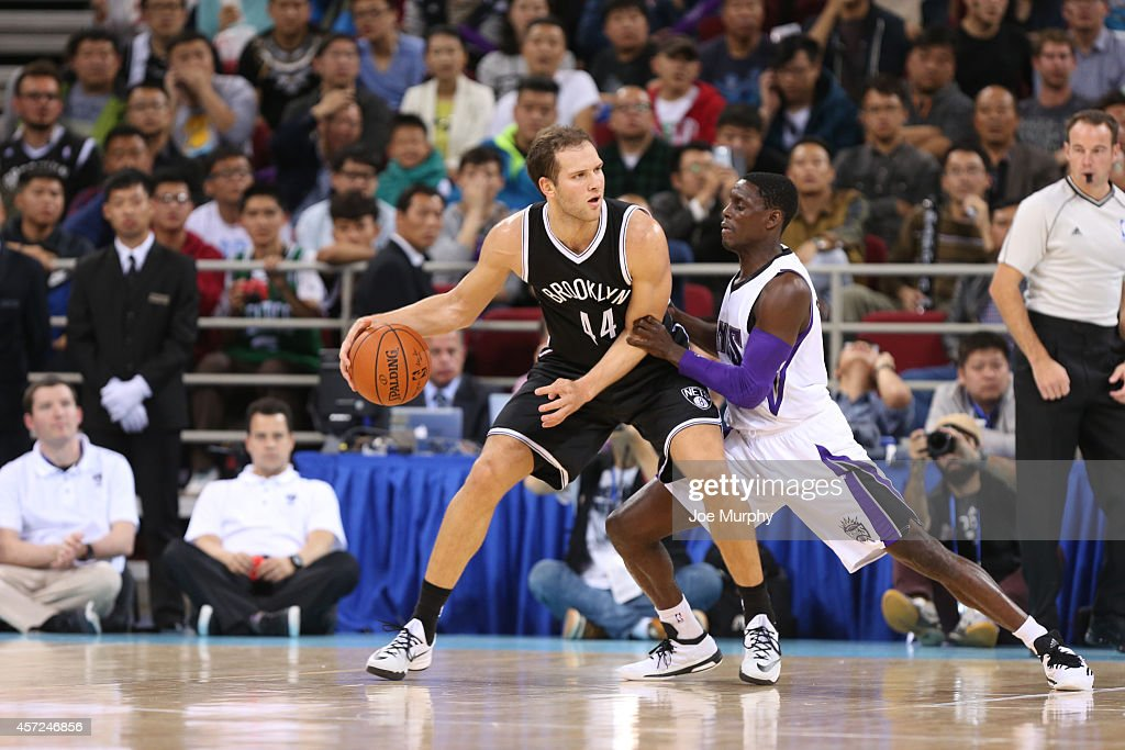 Bojan Bogdanovic #44 of the Brooklyn Nets handles the ball against <a gi-track='captionPersonalityLinkClicked' href=/galleries/search?phrase=Darren+Collison&family=editorial&specificpeople=699031 ng-click='$event.stopPropagation()'>Darren Collison</a> #7 of the Sacramento Kings during the 2014 NBA Global Games at the MasterCard Center on October 15, 2014 in Beijing, China.