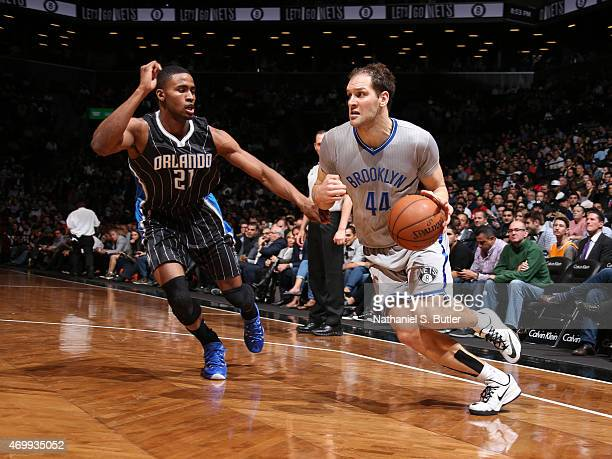 Bojan Bogdanovic of the Brooklyn Nets handles the ball against Maurice Harkless of the Orlando Magic on April 15 2015 at the Barclays Center in the...