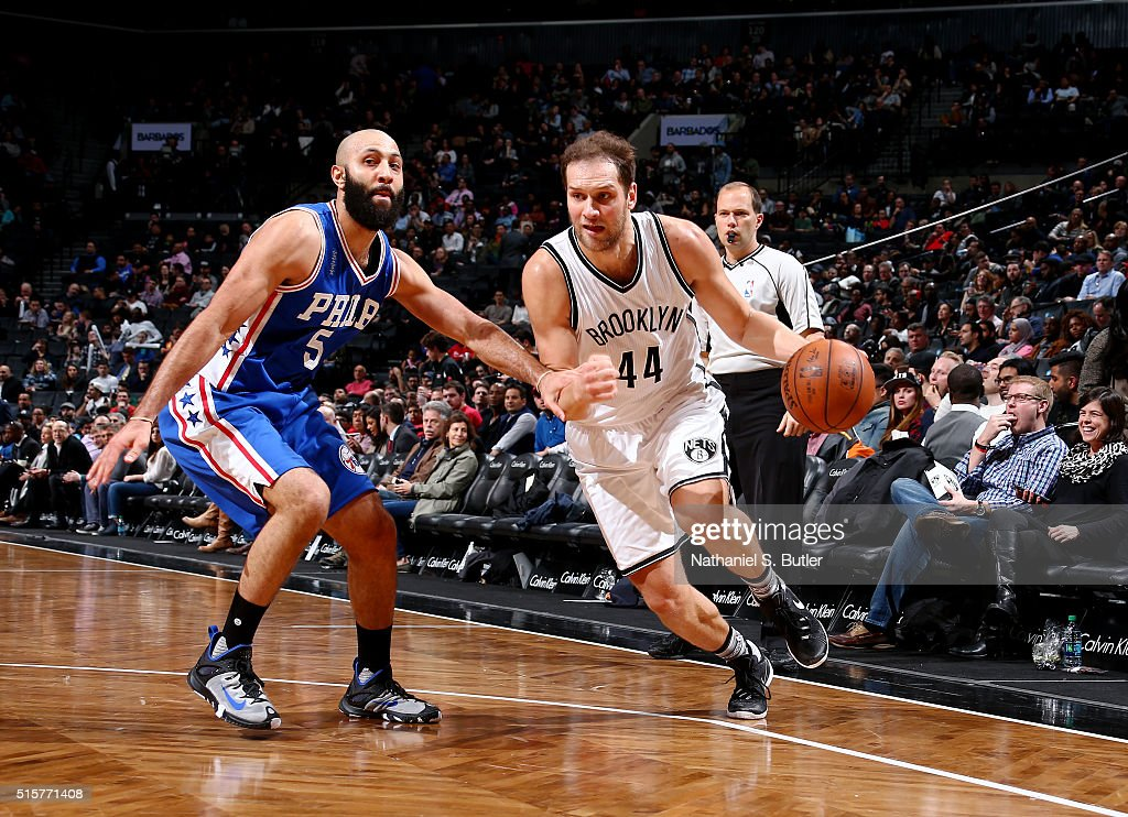 Bojan Bogdanovic #44 of the Brooklyn Nets handles the ball against <a gi-track='captionPersonalityLinkClicked' href=/galleries/search?phrase=Kendall+Marshall&family=editorial&specificpeople=6783056 ng-click='$event.stopPropagation()'>Kendall Marshall</a> #5 of the Philadelphia 76ers on March 15, 2016 at Barclays Center in Brooklyn, New York.
