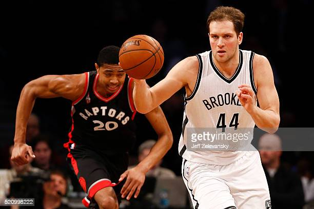 Bojan Bogdanovic of the Brooklyn Nets races up court in front of Bruno Caboclo of the Toronto Raptors during their game at the Barclays Center on...