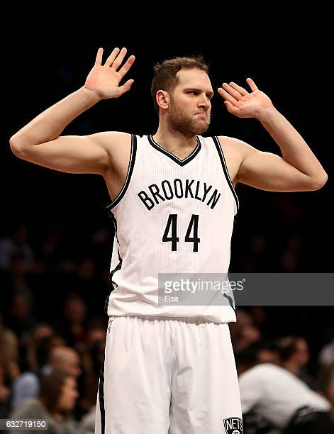 Bojan Bogdanovic of the Brooklyn Nets reacts after he is called for a foul in the first quarter against the Miami Heat at the Barclays Center on...