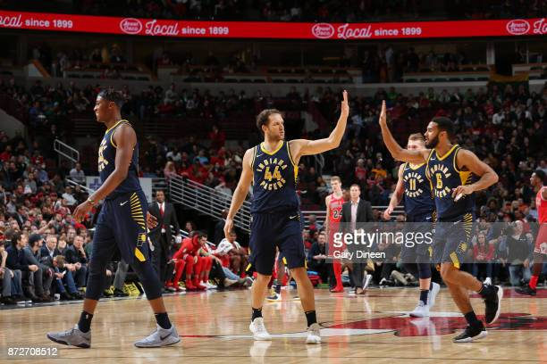 Bojan Bogdanovic of the Indiana Pacers and Cory Joseph of the Indiana Pacers high five during the game against the Chicago Bulls on November 10 2017...